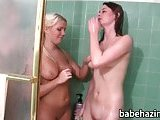 Lesbians make out in the shower and toy fucked