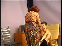 Redhead mature pleases a teen