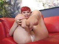 Redhead sucking her toe