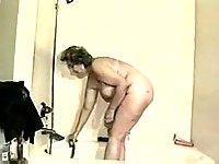 Busty mature taking bath