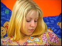 Cute blonde teen toys her twat