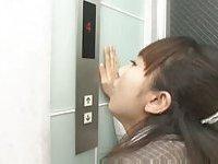 Asian lesbian outside the elevator