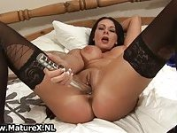 Horny mature wife in black stockings jilling