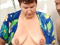 Brunette mature slut surrounded by three big cocks