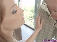 Anally creampied brunette handling cock
