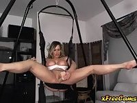 Milf plays with herself on sex swing