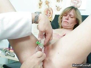 Doctor fucks a mature mom patient