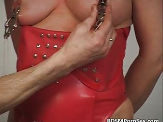 BDSM play where blonde slides big rubber dildo in her pussy