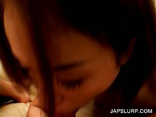 Asian cutie gives blowjob in close-up