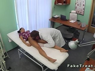 Doctor and nurse drilling patient in fake hospital
